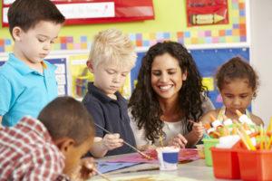 Elementary Age Schoolchildren In Art Class With Teacher
